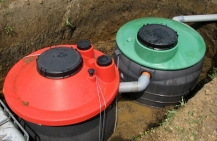 Red and green septic pumps